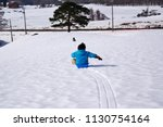 a child playing a sled at a ski ... | Shutterstock . vector #1130754164