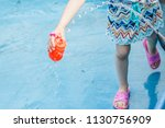 child playing with water in a... | Shutterstock . vector #1130756909