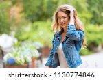 beautiful woman in the green... | Shutterstock . vector #1130774846