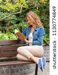 beautiful woman read an old... | Shutterstock . vector #1130774849