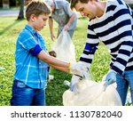 kids picking up trash in the... | Shutterstock . vector #1130782040