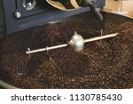 the freshly roasted coffee... | Shutterstock . vector #1130785430