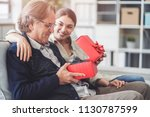 young daughter gives her father ...   Shutterstock . vector #1130787599