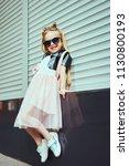 lifestyle portrait of stylish... | Shutterstock . vector #1130800193