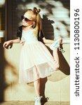 lifestyle portrait of stylish... | Shutterstock . vector #1130800196