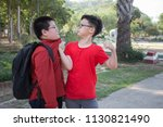 young boy students fighting  in ... | Shutterstock . vector #1130821490