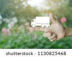 truck flat icon on finger over... | Shutterstock . vector #1130825468