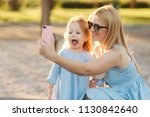 mom and her little daughter... | Shutterstock . vector #1130842640