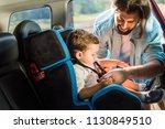 handsome father fastening son... | Shutterstock . vector #1130849510