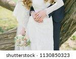 the bridegroom's hands hold the ... | Shutterstock . vector #1130850323