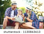young and happy family is... | Shutterstock . vector #1130863613