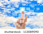 Cloud computing concept with woman hand on blue sky background - stock photo