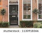 typical facade of the dutch...   Shutterstock . vector #1130918366