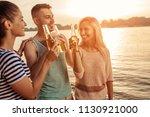shot of group of friends... | Shutterstock . vector #1130921000