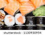 salmon and caviar rolls served... | Shutterstock . vector #1130930954