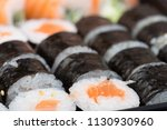 salmon and caviar rolls served... | Shutterstock . vector #1130930960