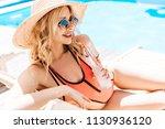 beautiful smiling young woman... | Shutterstock . vector #1130936120