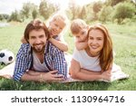 portrait of family lying on... | Shutterstock . vector #1130964716