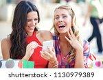 beautiful young women having... | Shutterstock . vector #1130979389
