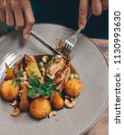 grilled duck served with potato ... | Shutterstock . vector #1130993630