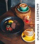 dark chocolate mousse dessert... | Shutterstock . vector #1130994299
