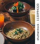 spaghetti pasta with pesto... | Shutterstock . vector #1130994320