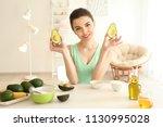 young woman making nourishing... | Shutterstock . vector #1130995028