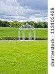 white gazebo by a pond | Shutterstock . vector #113102428