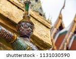 Giant Guardian Statue In Wat...
