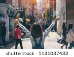 young asian woman traveler... | Shutterstock . vector #1131037433