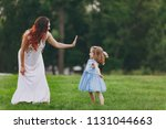 joyful woman in light dress...   Shutterstock . vector #1131044663