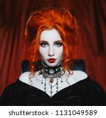 gothic woman is a vampire with... | Shutterstock . vector #1131049589