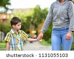 mother and son holding hand in... | Shutterstock . vector #1131055103
