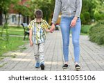 mother and son holding hand in... | Shutterstock . vector #1131055106