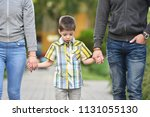 mother  father and son holding... | Shutterstock . vector #1131055130