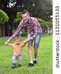 baby boy taking first steps... | Shutterstock . vector #1131055133
