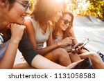 image of young happy three... | Shutterstock . vector #1131058583