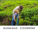 father and son are traveling on ... | Shutterstock . vector #1131060560