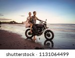 couple sitting on motorcycle on ... | Shutterstock . vector #1131064499