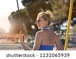 blonde woman enjoying... | Shutterstock . vector #1131065939