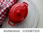 red ceramic dish for baking... | Shutterstock . vector #1131067223