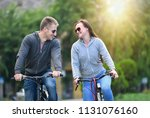 young couple riding bicycle... | Shutterstock . vector #1131076160