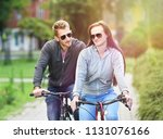 young couple riding bicycle... | Shutterstock . vector #1131076166