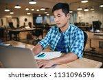 young asian designer working... | Shutterstock . vector #1131096596