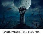 zombie hands rising in dark... | Shutterstock . vector #1131107786