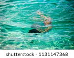 little girl enjoying snorkeling ... | Shutterstock . vector #1131147368
