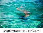 little girl enjoying snorkeling ... | Shutterstock . vector #1131147374