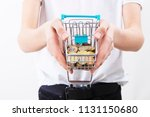 hands with shopping cart and... | Shutterstock . vector #1131150680