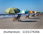 sun chairs and sun umbrellas on ... | Shutterstock . vector #1131174206