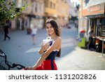 beautiful woman holding paper... | Shutterstock . vector #1131202826